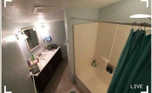 Hidden bathroom camera recording from a ceiling